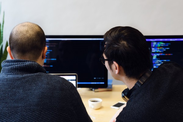programmers-reviewing-code-on-computer